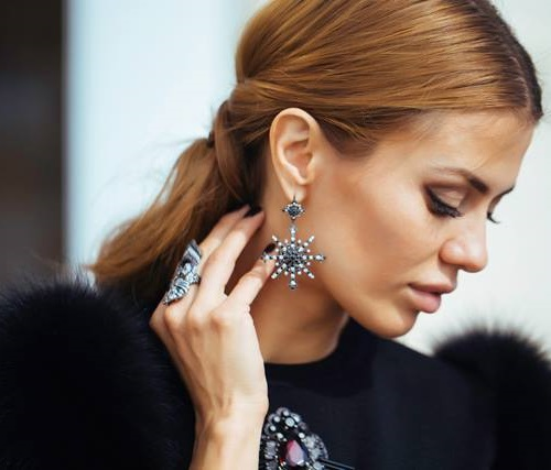 Russian model Victoria Bonya wearing Bochic conquistador ring and black and white diamond earrings