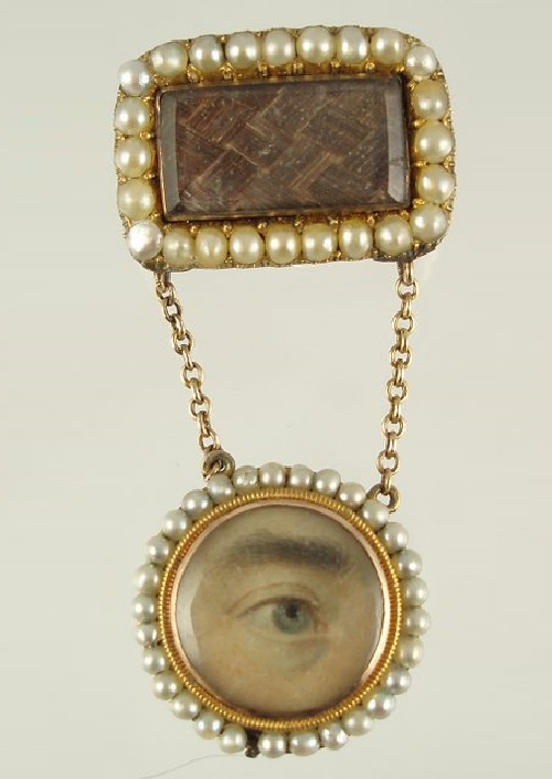 Lover's eye. C. 1820, man's miniature eye, hand painted on ivory, set in a yellow gold