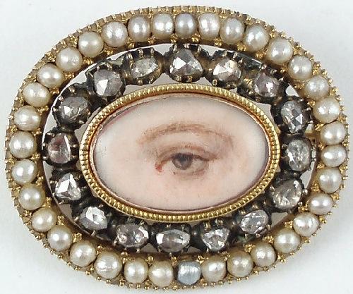 Mourning eye miniature. English. Circa 1820. Eye miniature brooch surrounded by diamonds set in black enamel and with a split pearl border