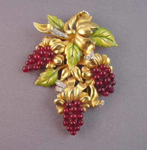 Ralph DeRosa red glass grapes fur clip with green enameled leaves and clear rhinestone accents all set in gold tone