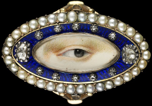 The oval ring of pink gold surrounded by blue enamel with ten small and two large diamonds in a frame made from freshwater pearls. c. 1790. from Dr. David and Mrs. Nan Skier Collection