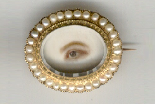 This eye miniature brooch is a wonderful painting on ivory of a woman's eye. Gold and pearls. Dated 1845