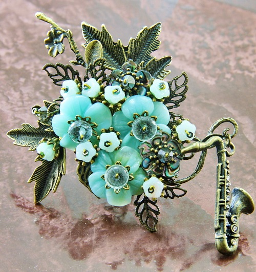 Brooch 'Evening Blues'. Carved amazonite, carved mother of pearl Abalon, Czech glass, aqua quartz and Swarovski crystals