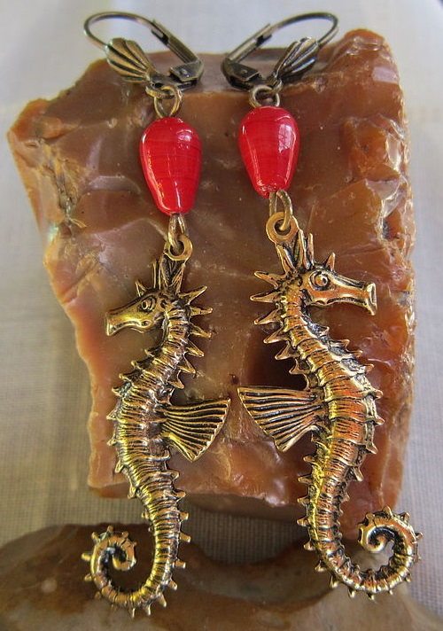 Earrings 'Fairy Tale Seahorse' made of red coral and bronze. Tatiana and Ben jewellery