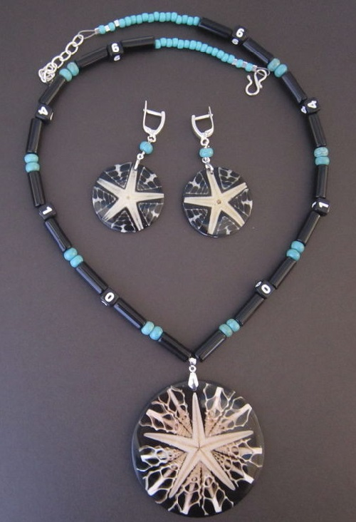 Set 'Receding Universe', made of sea shells, starfish, black onyx, turquoise and silver. Tatiana and Ben jewellery