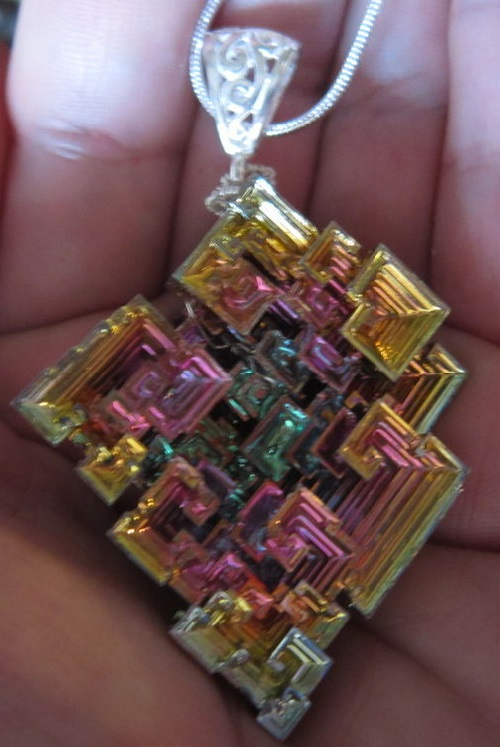 Silver pendant 'Parallel Worlds', made of beautiful and unusual crystal bismuth, shining with all the colors of the rainbow and silver