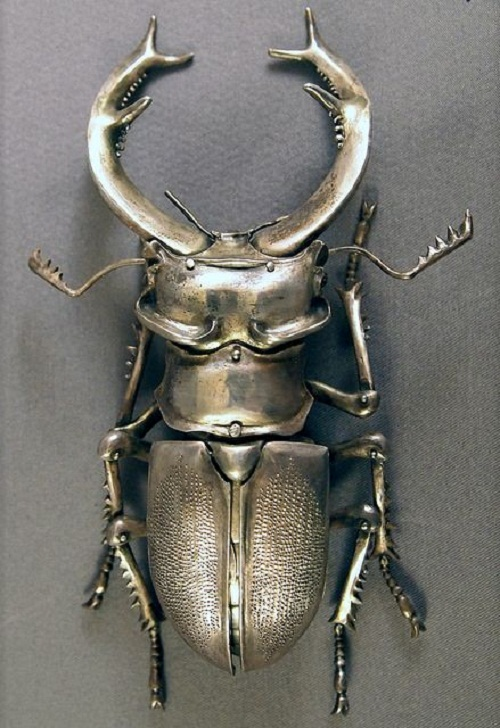 Insect jewellery symbolism. Victorian silver brooch