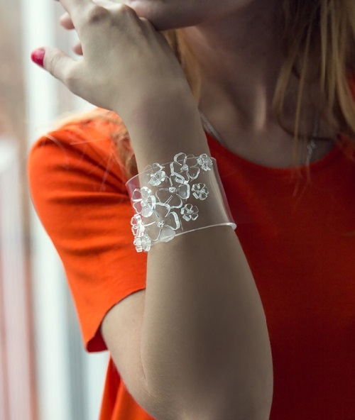 Bracelet made of plastic, decorated with flowers
