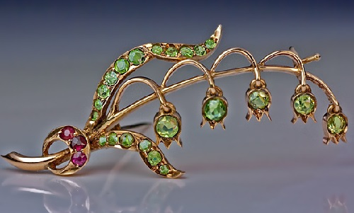 Russian Antique Lily of the Valley Brooch-Pin. St. Petersburg, 1908 - 1917. Gold brooch, Uralian demantoid garnets, synthetic rubies