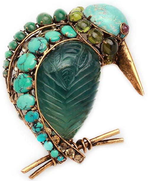 Iradj Moini Volume brooch in the form of a bird. Persian turquoise, carved amethyst, tourmaline, metal alloy, gilding
