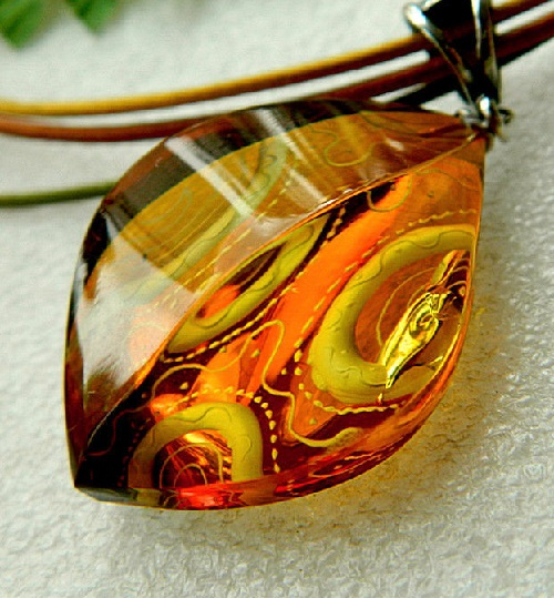 Amber Kaleidoscope. Amber Pendant of wine color