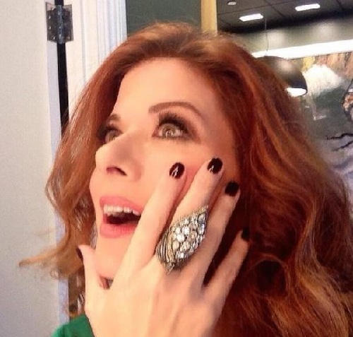 Debra Messing definitely loves the ring