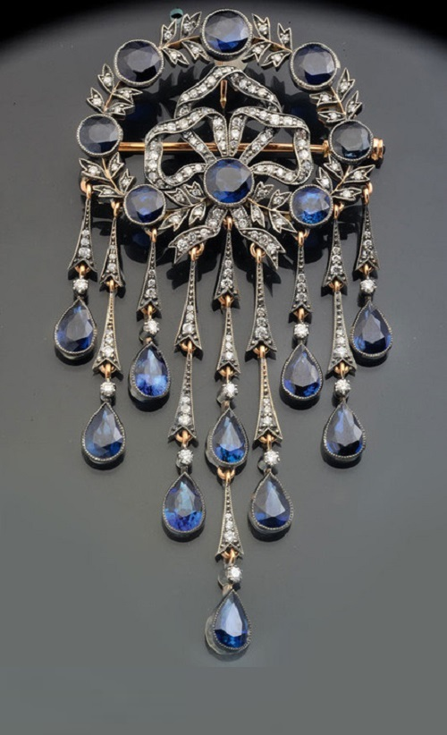 Pendant brooch of gold and silver with diamonds and sapphires