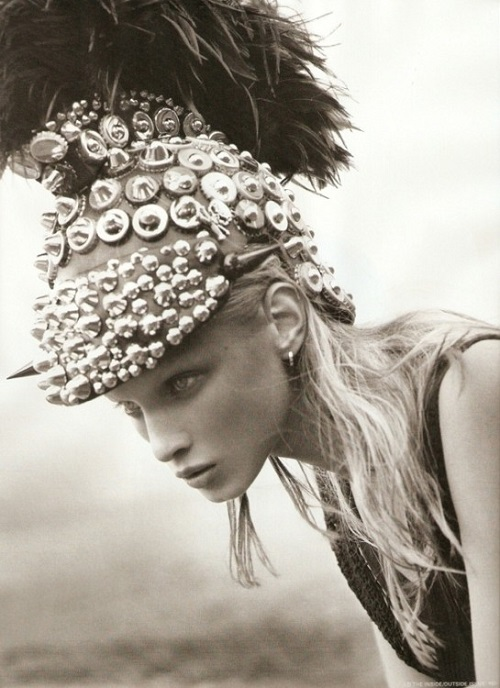 Russian fashion model Anna Selezneva in bottle cap armor and helmet