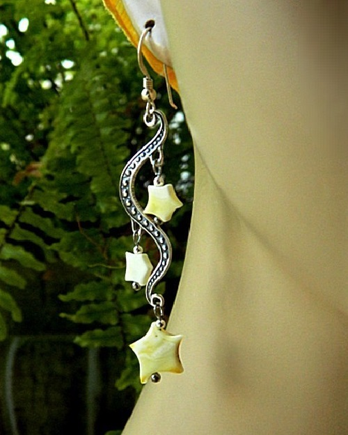 Stars earrings of white amber