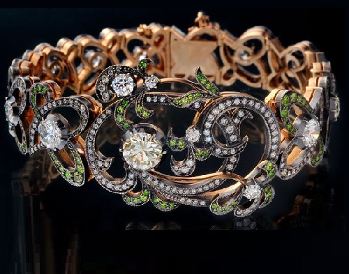 The bracelet of gold and silver with diamonds and demantoid