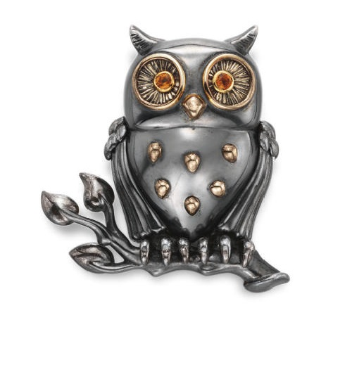 A blackened steel brooch Owl