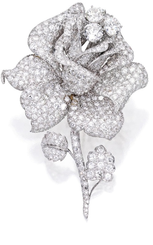 A rose blossom. Platinum and diamond brooch, David Webb