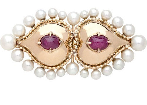 An 18 karat gold Mogul inspired brooch with pearls and cabochon rubies
