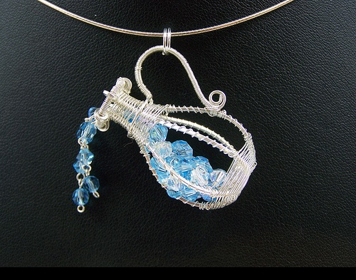 Aquarius Astrological sign. Wire-work pendant by Huan Pham