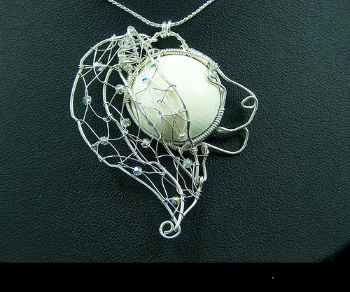 Astrological sign Leo. Wire-work pendant by Huan Pham