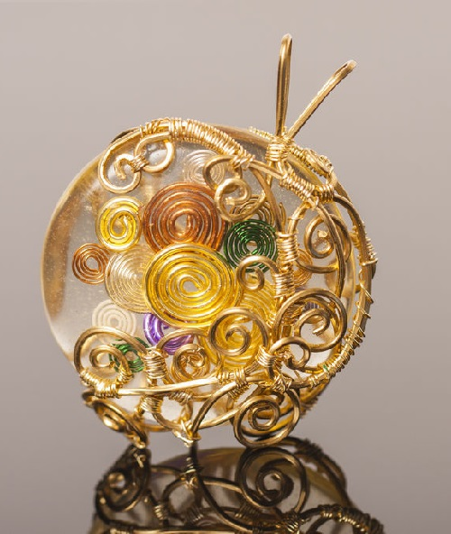 Author pendant Spirals made in two different techniques - classical technique of wire wrap and creating volume cabochons with epoxy resin (ice resin)