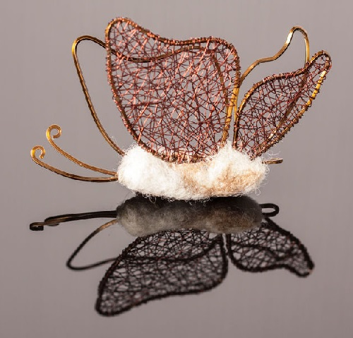 Butterfly brooch in the original technique of weaving. Very soft and pleasant combination of chocolate-colored wire and cream-colored felt