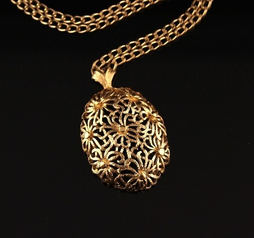 Delicate vintage pendant from Monet coated gold color