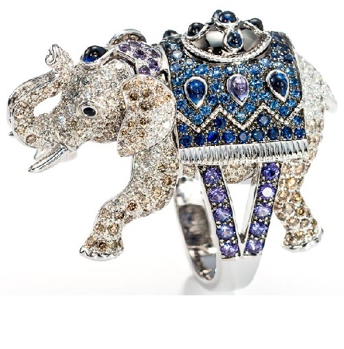 Elephant ring set with white and brown diamonds, blue and purple sapphires, cabochon pear shaped blue and purple