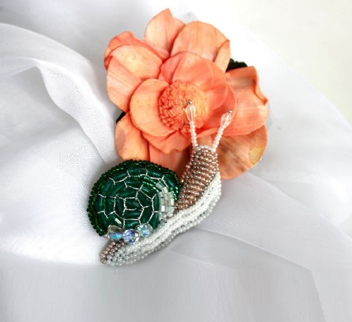Emerald snail. Sweet and gentle brooch
