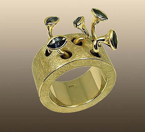 Fancy gold ring 'Chicks' of white and lemon gold with 5 sapphires. Russian jeweler Ilya Maksimov
