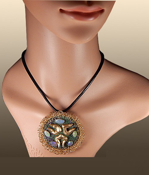 Gold exclusive pendant Medusa. Yellow gold, natural opals, emeralds, sapphires, frosted gold, black rhodium