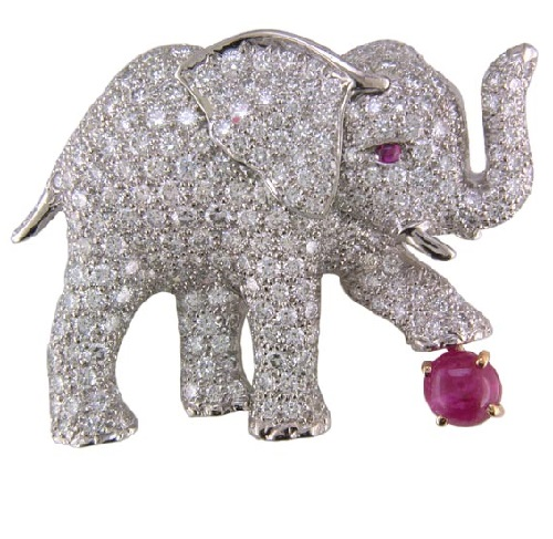 Gold platinum ruby diamond elephant brooch. Oscar Heyman & Brothers