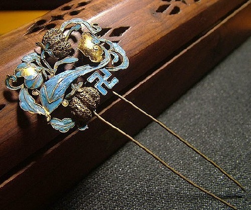 Hair pin encrusted with blue kingfisher feathers