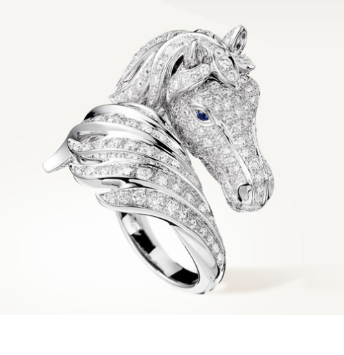 Pegasus Ring set with pavé diamonds and two cabochon sapphires, in white gold. French jewellery house Boucheron