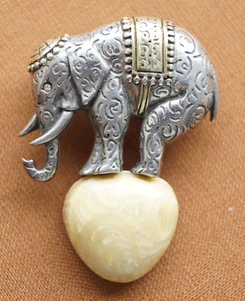 Rare vintage brooch of silver as an elephant on the ball. inlaid Swarovski, gilded. Labeled MMA (METROPOLITAN MUSEUM OF ART)