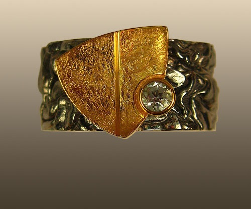 Silver ring with topaz and gold leaf 'Sail'