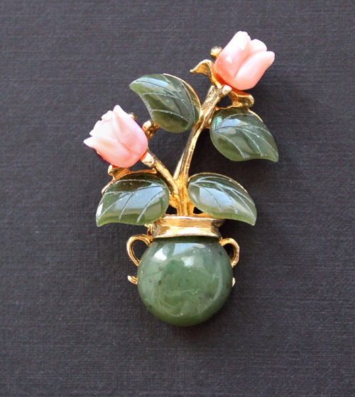 Vintage brooch made as the gentle bouquet of natural jade and coral. Marked Swoboda