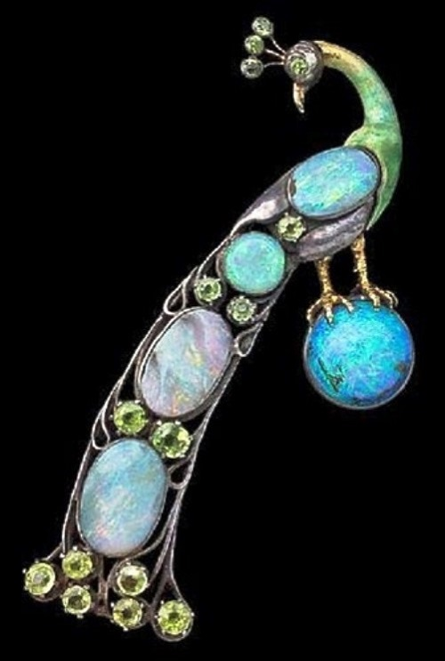 Charles Ashbee Art Nouveau jewelry. Guild of Handicraft Brooch In the form of a Peacock Standing on an opal orb. 1900. Silver, gold, opal, peridot