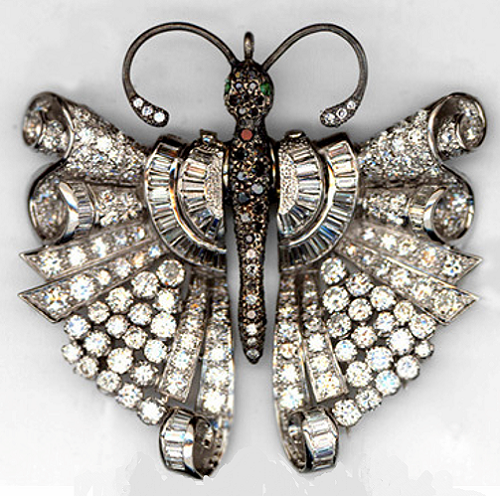 Art Deco style Pendant-Brooch Butterfly. White gold, round diamonds and baguettes. The body is oxidized and inlaid with colored stones and diamonds