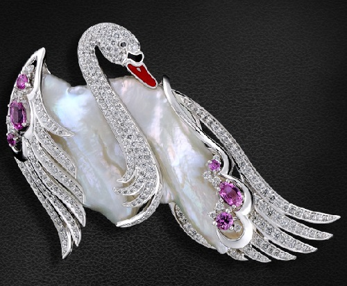Brooch 'Swan' with sea pearls, colored stones and diamonds in white gold