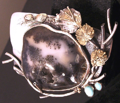 Brooch from the series 'flower of the sea'. metal, turquoise, moss agate