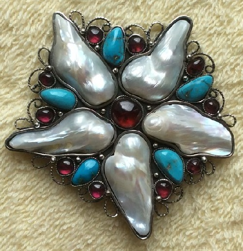 Brooch-pendant Starfish. Decorating with natural gems, created in a single copy. Exotic double pearl shaded with juicy natural garnet and delicate turquoise