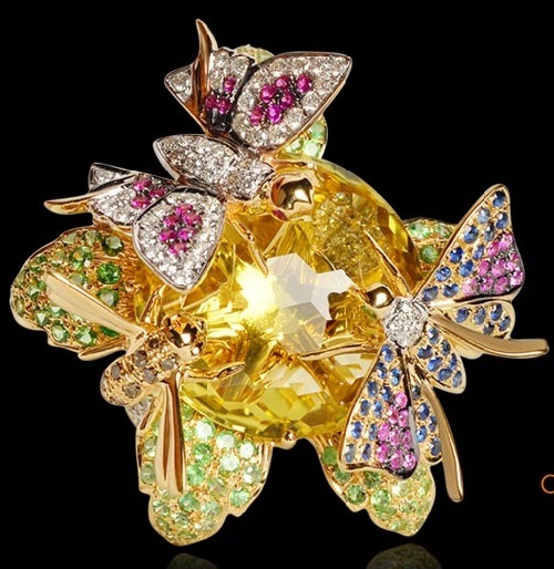 Butterfly ring with diamonds, tsavorites, rubies, sapphires and crystal set in 18k yellow gold. Farah Khan Ali