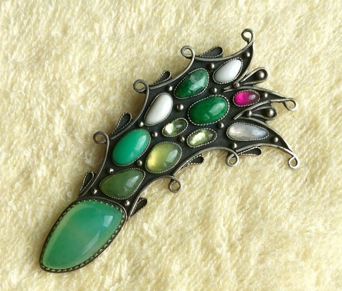 Comet Brooch. Copyright jewelery with natural gemstones manual processing, created in the single copy. Central chrysoprase processed in the form of bilateral cabochon