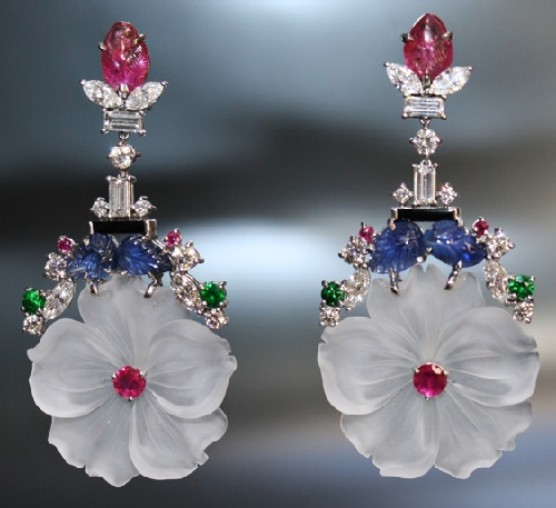 Diamonds, a carved rock crystal flower, sapphires, platinum earrings