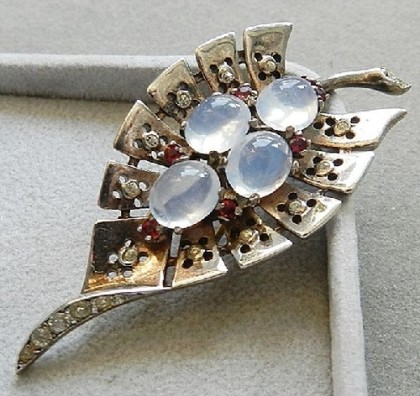Fur clip, a patent received by the Company in July 1946, sterling silver, gold-plated, jewelry glass, crystals