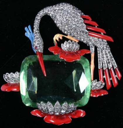 Water lily and bird on pond brooch pin. Crane pave set with rhinestones plus one large green rhinestone