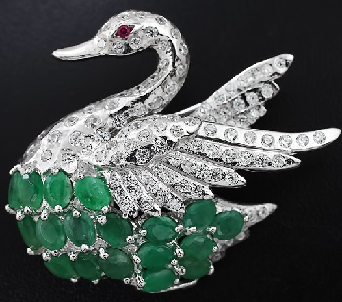 Silver brooch Swan with emeralds and ruby