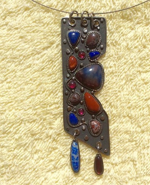 The Baikal Azure pendant. Minerals - lapis lazuli, jasper, Irnimit (blue jasper), extremely rare mineral, only fields found in the Far East, Russia